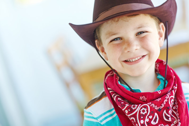 Kid in cowboy hat and bandana